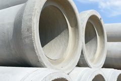 Industrial concrete drainage pipes stacked for construction. New tubes Royalty Free Stock Image