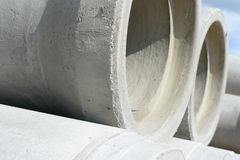 Industrial concrete drainage pipes stacked for construction. New tubes Stock Image