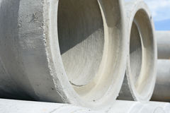 Industrial concrete drainage pipes stacked for construction. New tubes Royalty Free Stock Photos