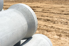 Industrial concrete drainage pipes stacked for construction. New tubes Stock Photography