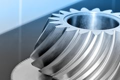 Industrial conical gear with spiral machine teeth. Royalty Free Stock Image