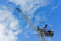 Industrial construction building crane against blue sky Stock Image
