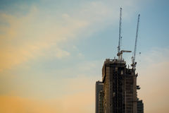 Industrial Construction building tower in sun set sky. Background Royalty Free Stock Image