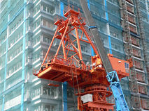 Industrial construction crane. And group of  workers near new building Stock Photo
