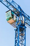 Industrial construction crane against blue sky.  Royalty Free Stock Photography