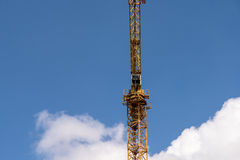 Industrial Construction Crane On Blue Sky Stock Photo