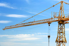 Industrial construction crane on blue sky background Stock Photo