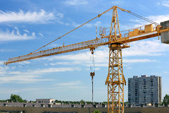 Industrial construction crane and buildings Stock Images