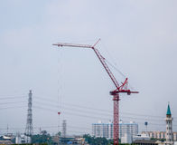 Industrial construction crane in the city Stock Photo