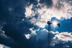 Industrial construction crane with dramatic sky background. Details of industry Royalty Free Stock Photos