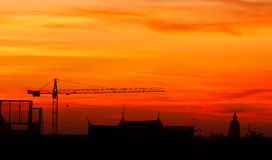 Industrial construction cranes. And building at sunrise Royalty Free Stock Photo