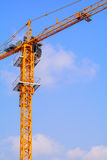 Industrial construction cranes. On the blue sky background royalty free stock photo