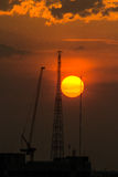 Industrial construction cranes and building silhouettes Royalty Free Stock Photo