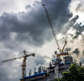 Industrial construction cranes and building silhouettes Stock Photo
