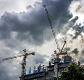Industrial construction cranes and building silhouettes Royalty Free Stock Photography