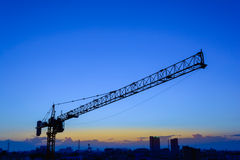 Industrial construction cranes and building. In the sunset stock photos