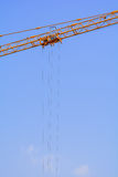 Industrial construction cranes cable. On the blue sky background stock images