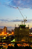 Industrial construction cranes and city Stock Photos
