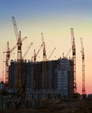 Industrial construction cranes silhouettes Stock Image