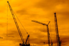 Industrial construction cranes. Silhouettes sunset Stock Images