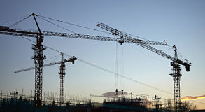 Industrial construction cranes site. Industrial construction cranes on building site Royalty Free Stock Images