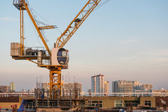 Industrial construction cranes, and under construction site building in the city Stock Photography
