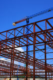Industrial construction site. New building structure and crane over blue sky Royalty Free Stock Photography