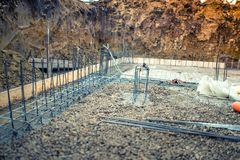 Industrial construction site, cement in foundation and reinforcement of steel bars Royalty Free Stock Photos