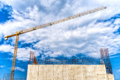 Industrial construction site with mega crane and reinforced steel concrete walls closeup Stock Photography
