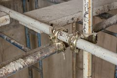 Scaffolding clamps. Industrial construction work use scaffolding clamps in site royalty free stock photos