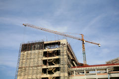 Industrial construction: yellow crane with blue sk Royalty Free Stock Images