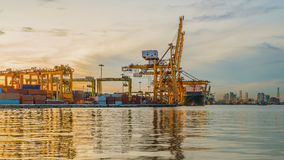 Industrial Container Cargo freight ship with working crane bridg Stock Photography