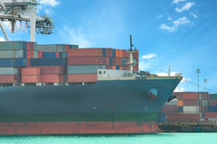 Industrial Container Cargo freight ship with working crane bridg Royalty Free Stock Photos