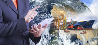 Industrial Container Cargo freight ship with working crane bridg. E in shipyard with truck (Elements of this image furnished by NASA Stock Image