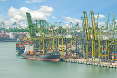 Industrial Container Cargo freight ship with working crane Royalty Free Stock Photo