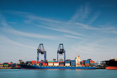 Industrial Container Cargo freight shipping by crane Stock Image