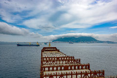 Industrial container ship enters the Strait of Gibraltar Stock Photos