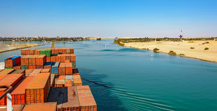 Industrial container ship passing through Suez Canal with ship's Stock Images