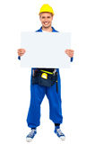 Industrial contractor showing blank billboard Royalty Free Stock Photos