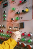 Industrial Control Board. Technician operating an control board in an industrial plant Royalty Free Stock Images