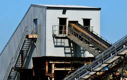 Industrial conveyor for aggregate transport. Conveyor belt and associated structures involved in aggregate transport Royalty Free Stock Photos