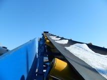 Industrial conveyor. Nindustrial conveyor against the blue sky Royalty Free Stock Photos
