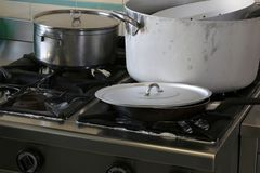 Industrial cooker of a kitchen of a restaurant with gigantic pot. Large industrial cooker of a kitchen of a restaurant with gigantic pots and lids Royalty Free Stock Photos