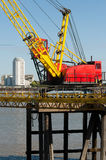 Industrial Crane. Working the Thames Stock Photo