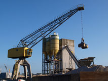 Industrial crane. Hauling sand on ship Stock Photography