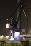 Industrial crane. In a port with nocturnal reflections Royalty Free Stock Images