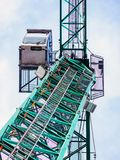 Industrial crane from below against a blueish sky stock photo