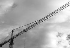Industrial crane black and white background Stock Images
