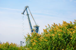 Industrial crane. Industrial nautical crane loading cargo Royalty Free Stock Photography
