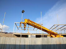 Industrial Crane operating and blue sky Stock Photos